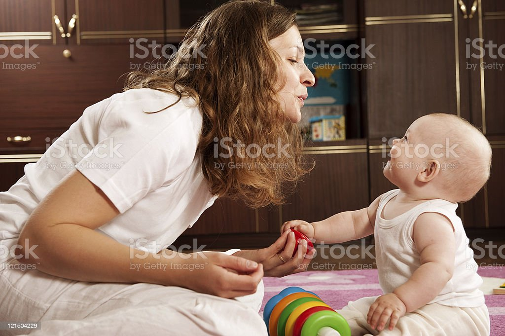 Mother playing with baby royalty-free stock photo