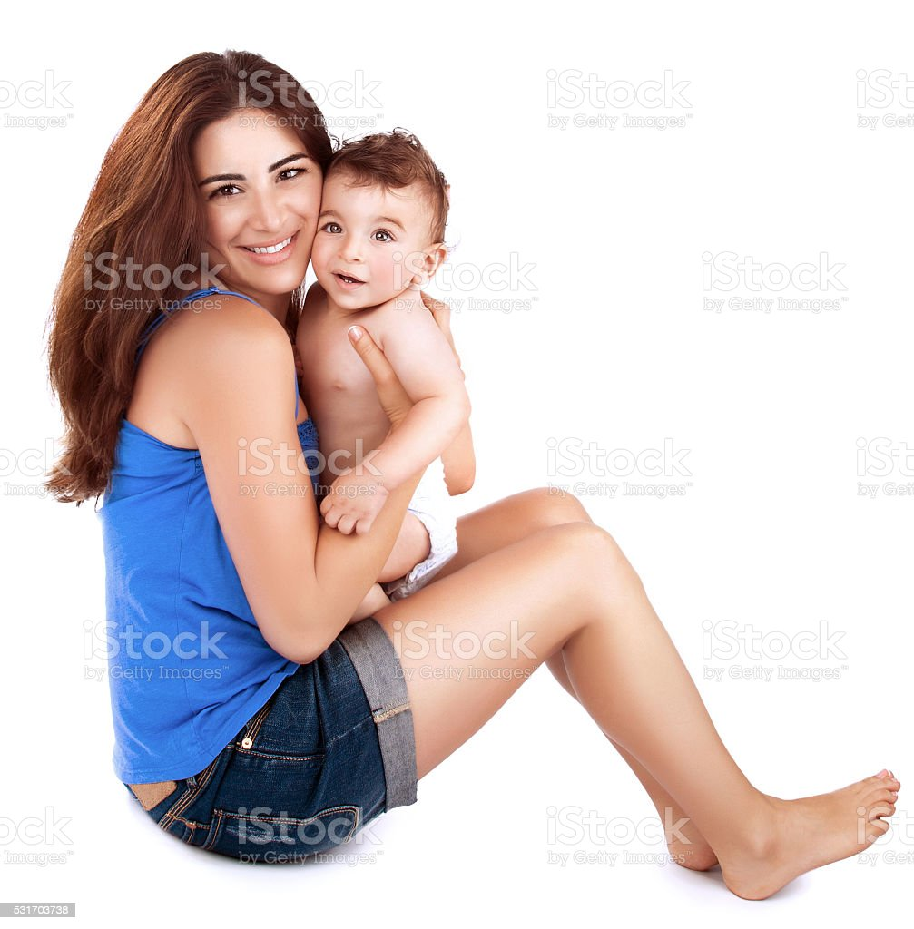Mother playing with baby stock photo