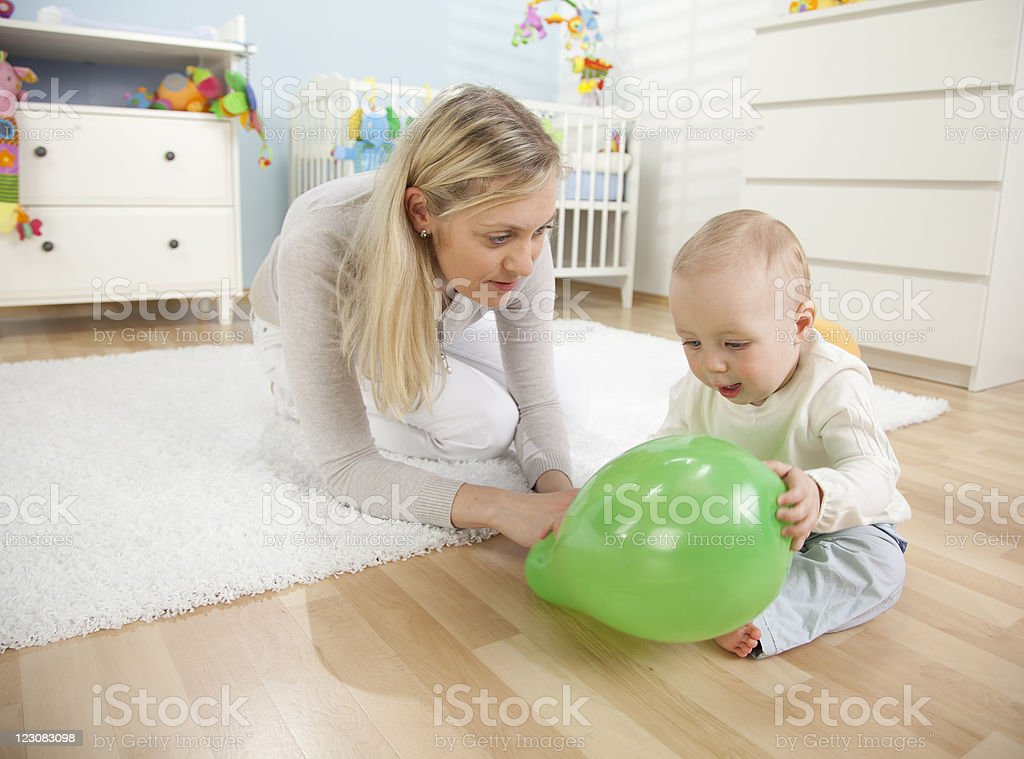 Mother Playing With Her Baby Boy royalty-free stock photo