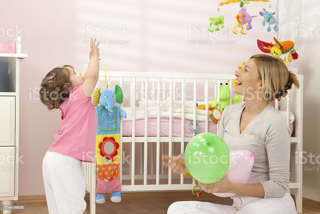 Mother Playing With Her Baby Girl royalty-free stock photo
