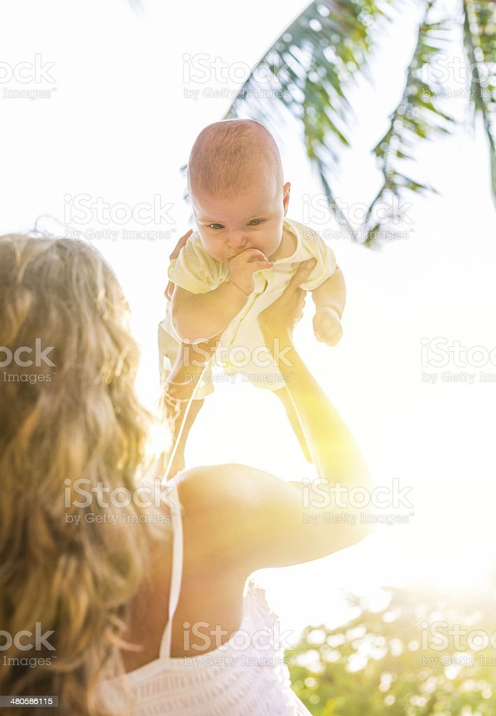 Mother playing with her child stock photo