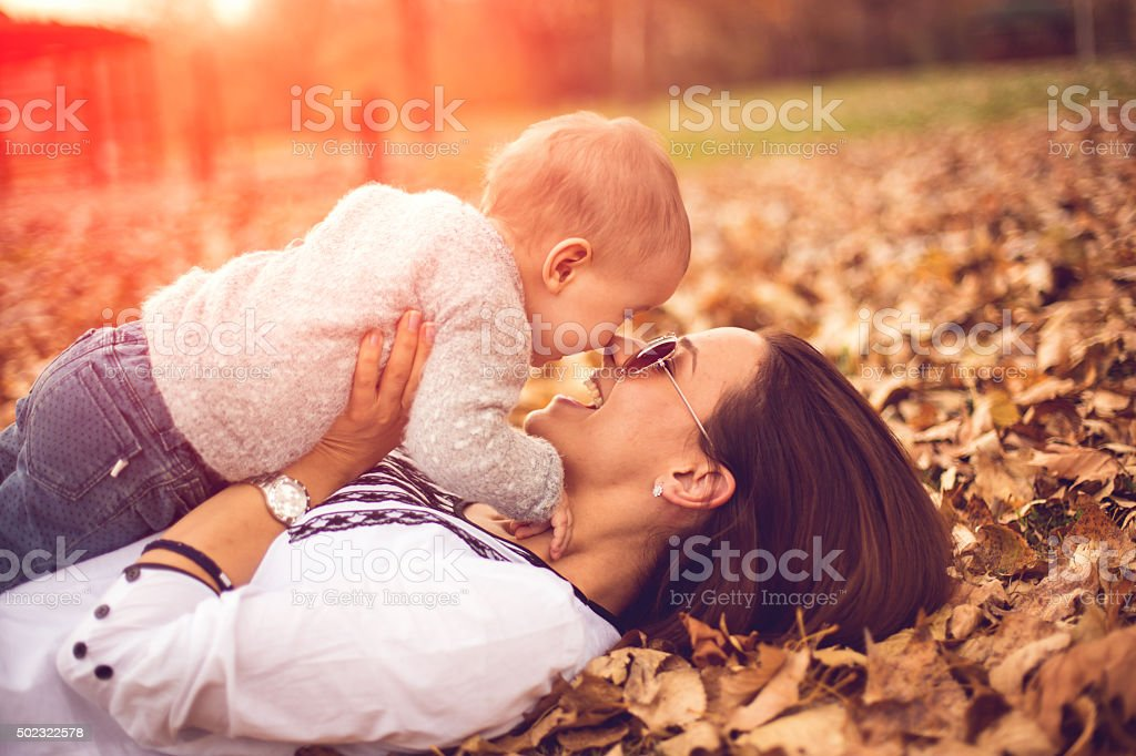 Mother playing with his little daughter stock photo