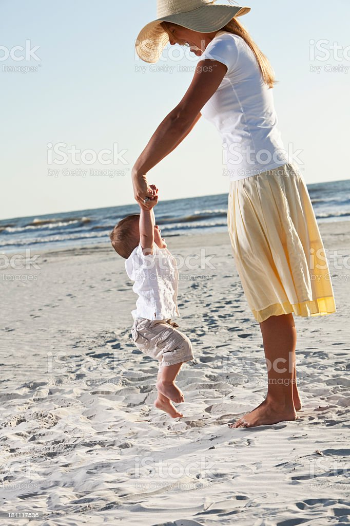 Mother playing with little boy at beach royalty-free stock photo