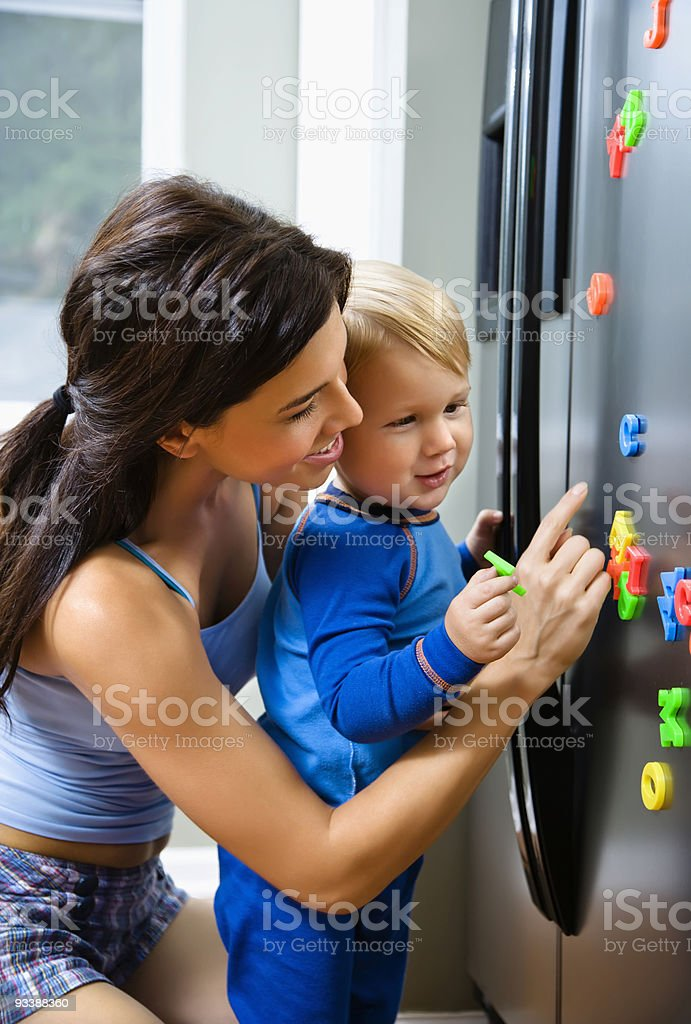 Mother playing with son stock photo