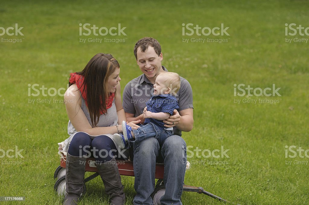 Mother Playing With Son While Sitting on Wagon royalty-free stock photo
