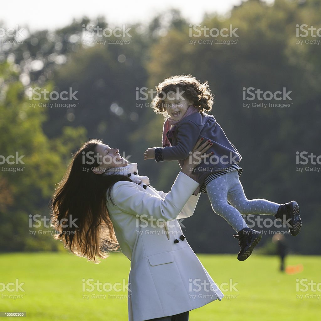 Mother plays with daughter stock photo