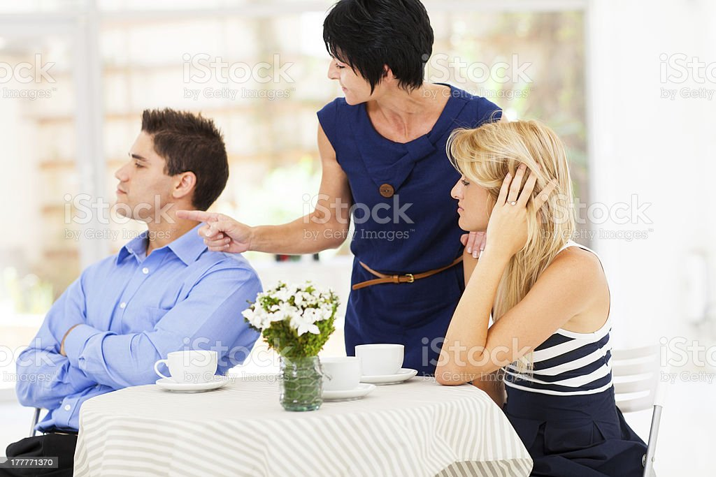 mother pointing finger at son-in-law stock photo