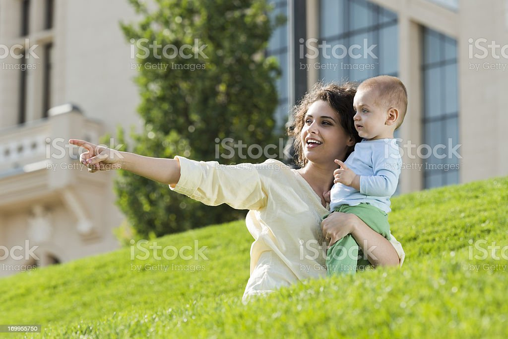 Mother pointing something to her son royalty-free stock photo
