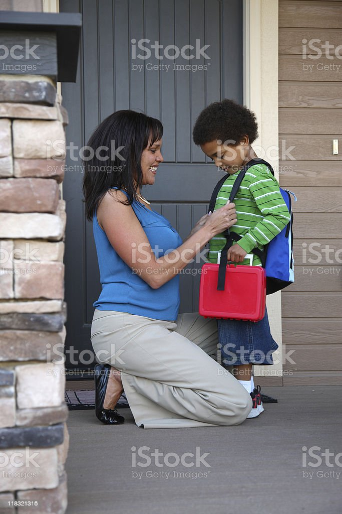 Mother prepares son for his first day of school royalty-free stock photo