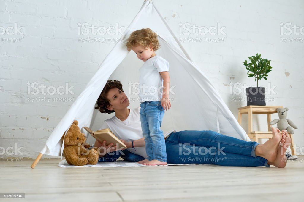Mother, read me book! stock photo