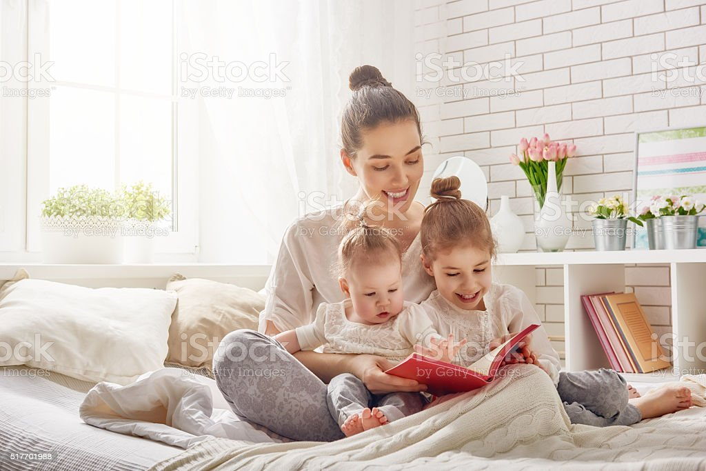 mother reading a book royalty-free stock photo