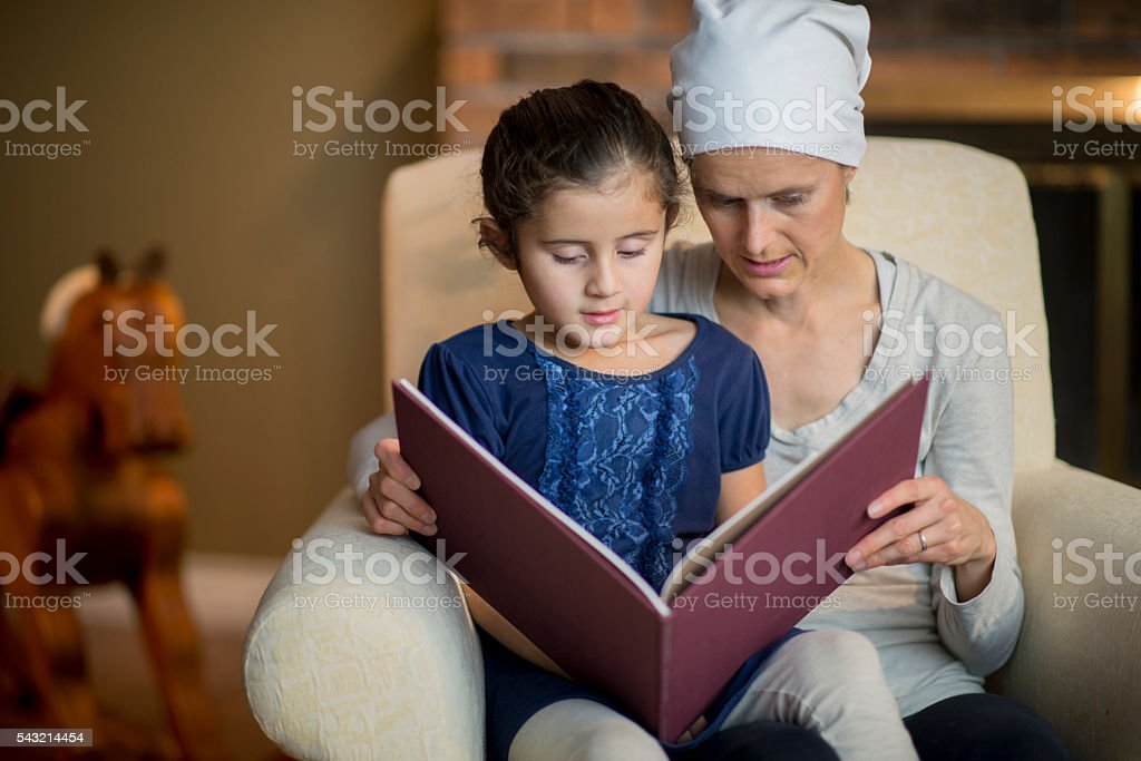 Mother Reading a Book to her Daughter stock photo