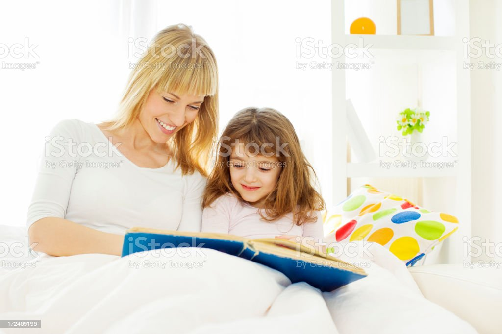 Mother Reading Book to child. royalty-free stock photo