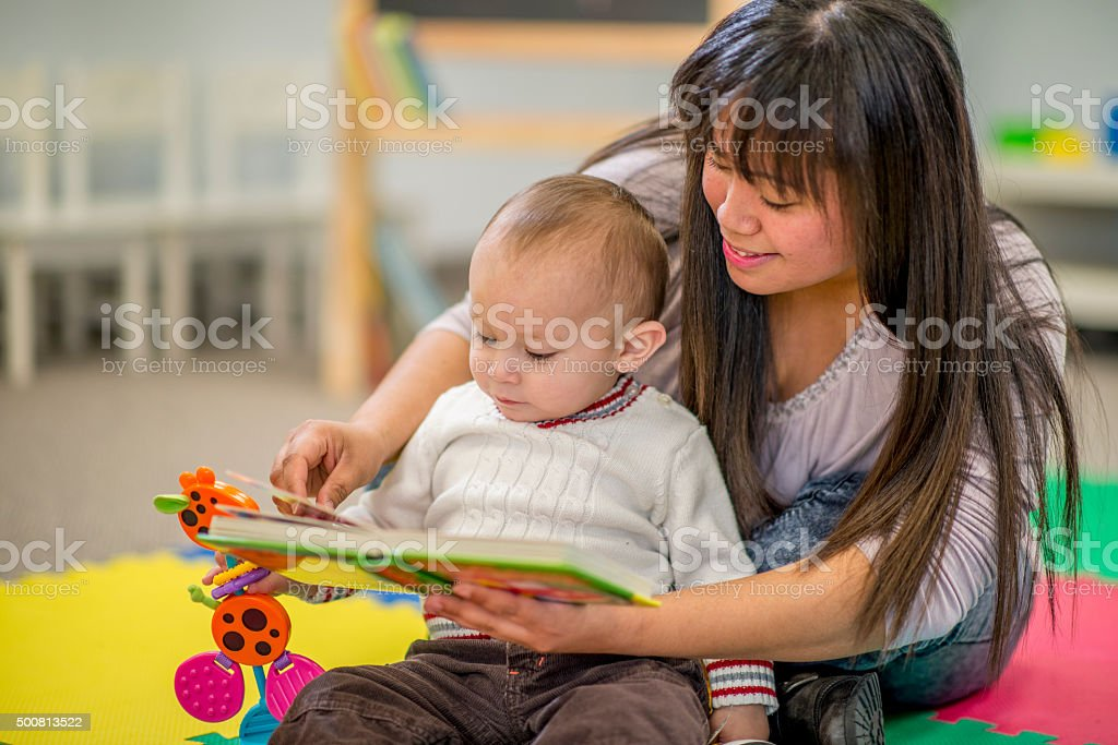 Mother Reading Her Son a Book stock photo