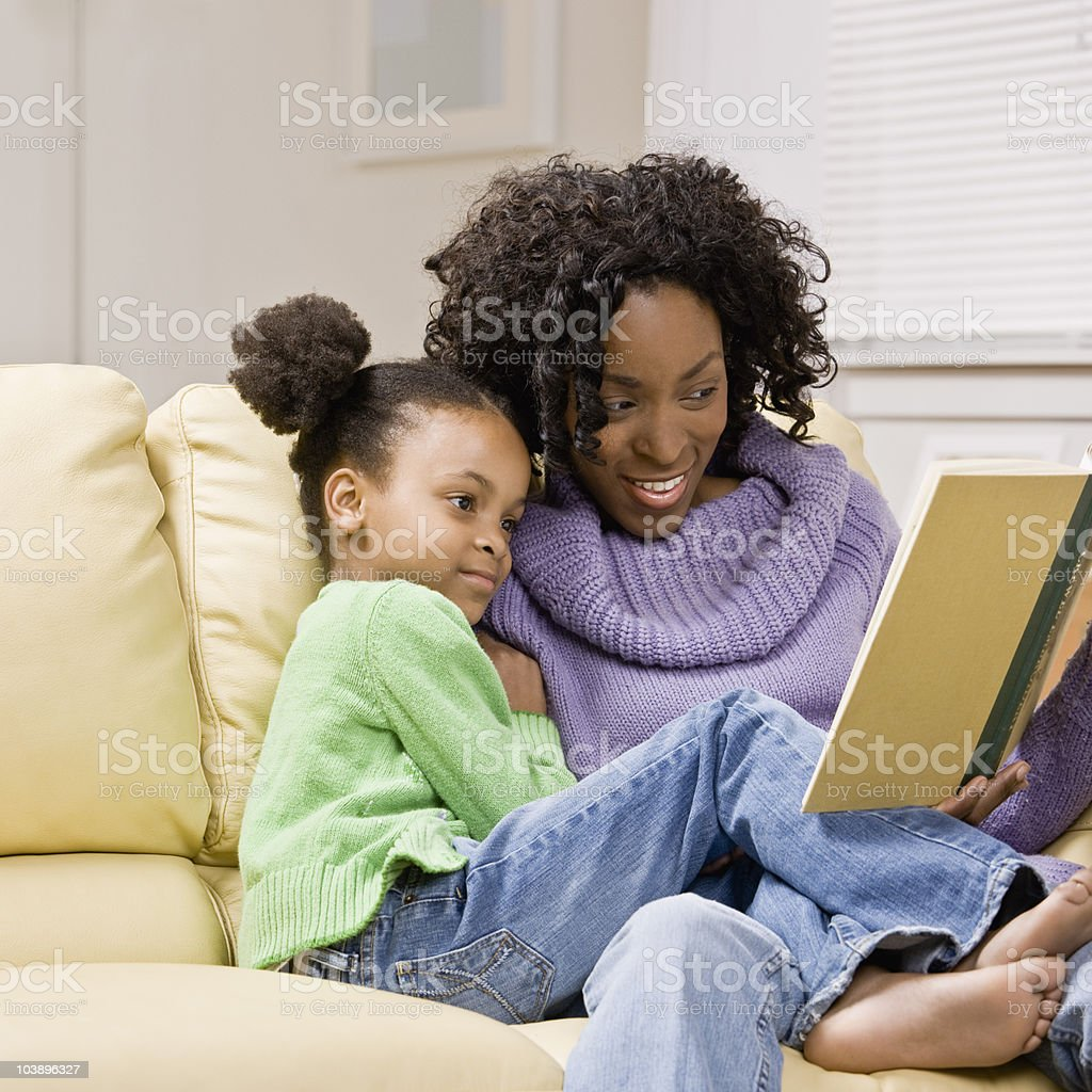 Mother reading to her Daughter royalty-free stock photo