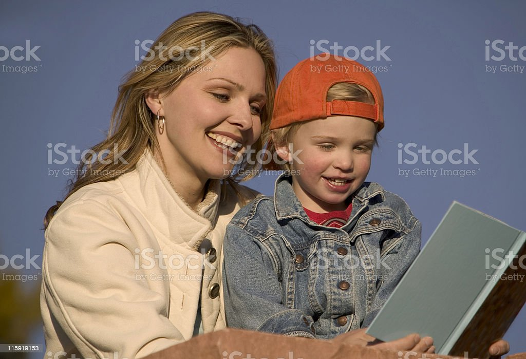 Mother Reading to Son stock photo