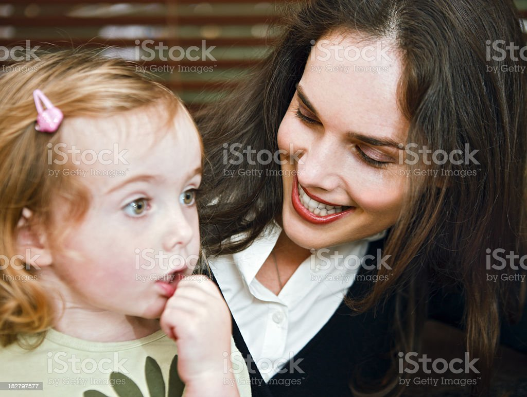 Mother reassures worried or shy toddler daughter stock photo