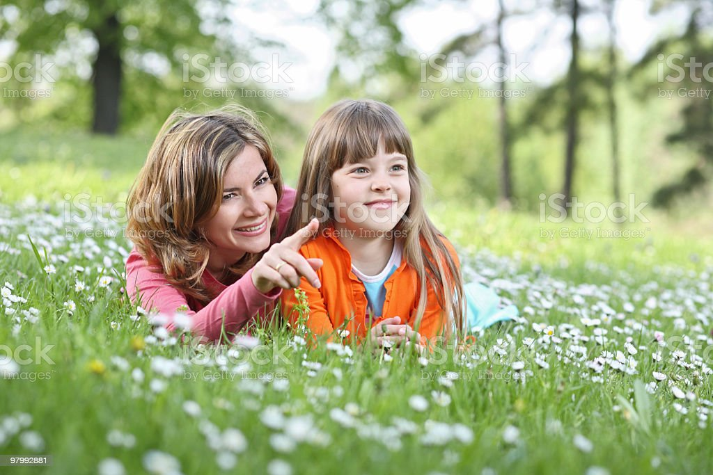 Mother resting with daughter. stock photo