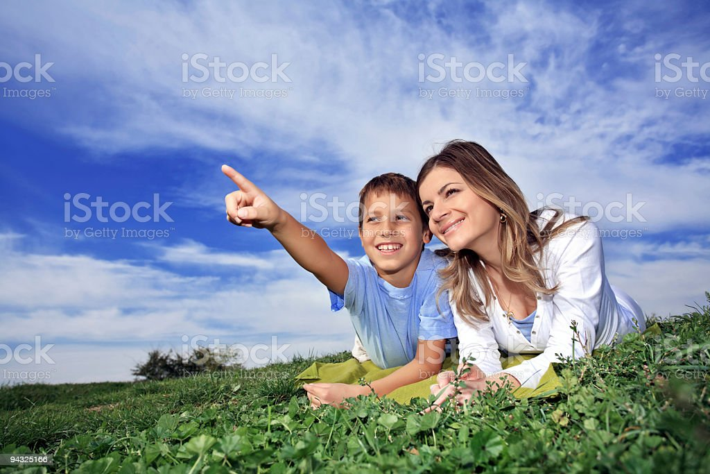 Mother resting  with son royalty-free stock photo