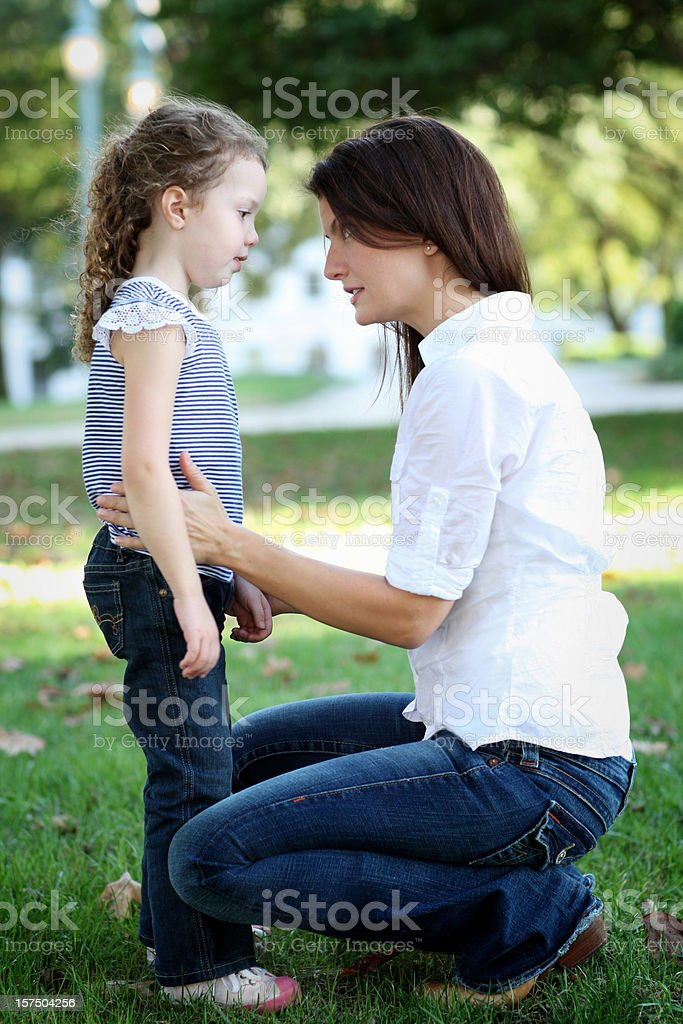 Mother scolding her daughter. stock photo