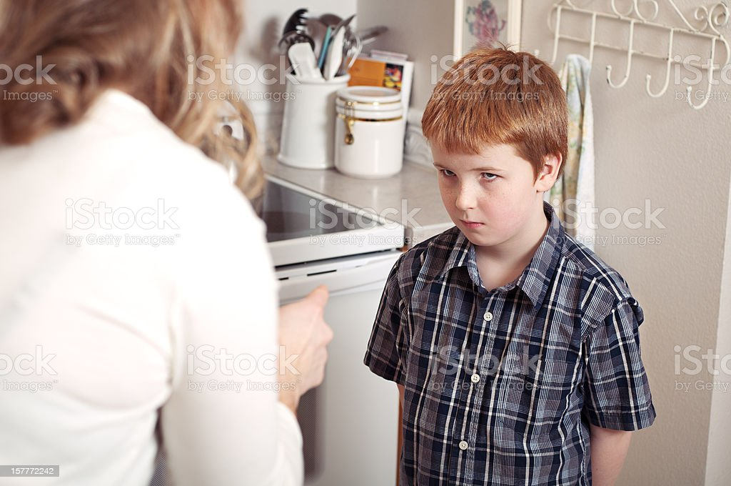 Mother scolding son stock photo