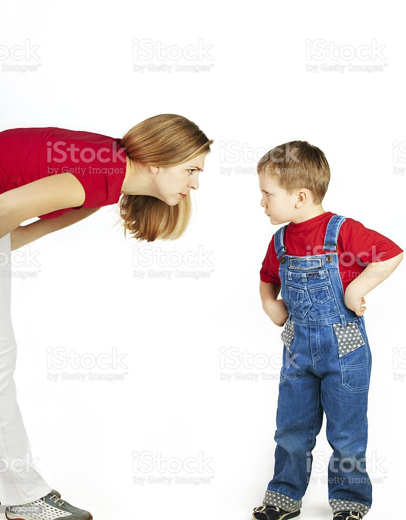Mother scolds her son stock photo