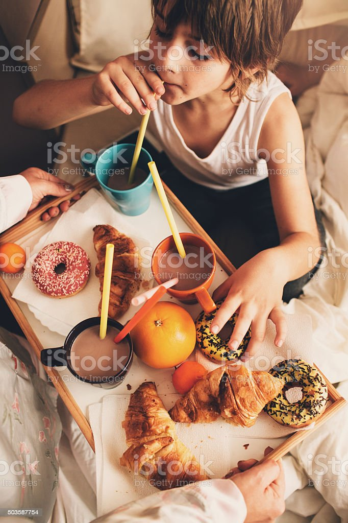 Mother served delicious breakfast for her children stock photo