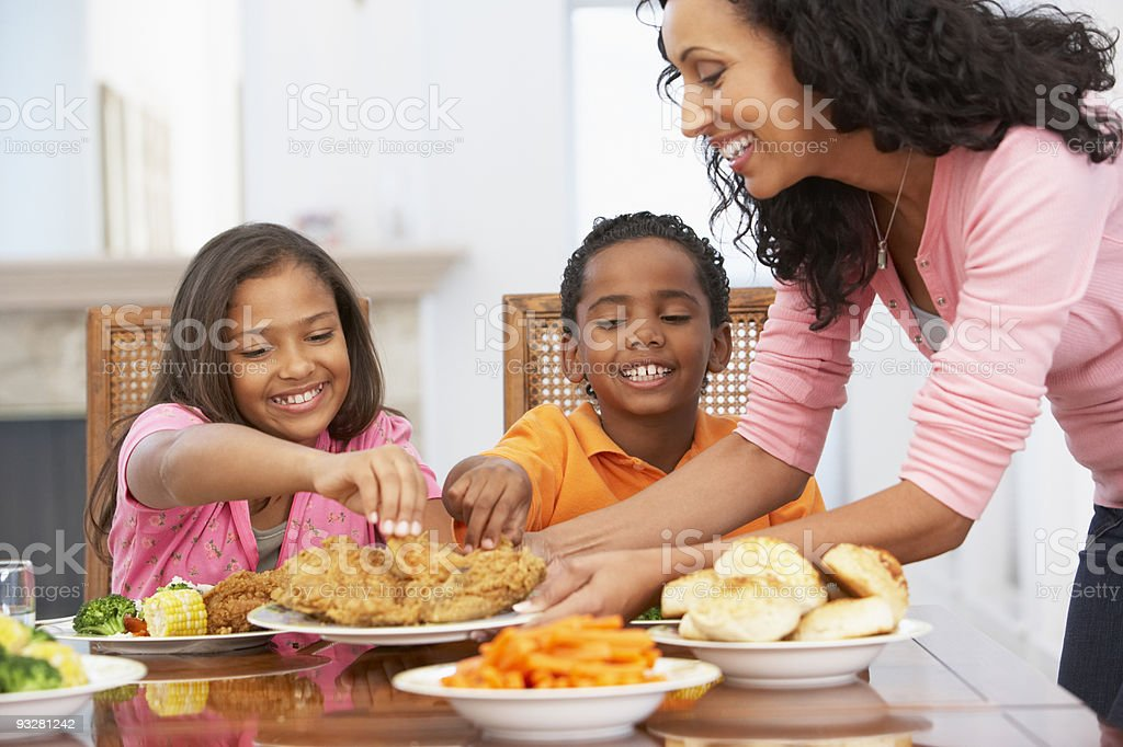 Mother Serving A Meal stock photo