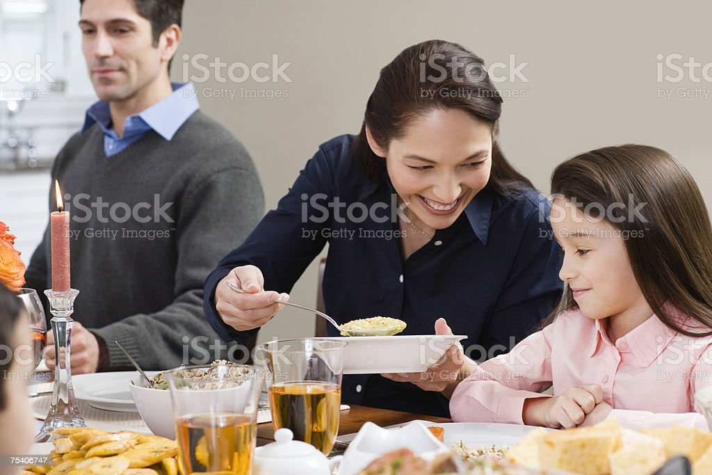 Mother serving food to daughter royalty-free stock photo