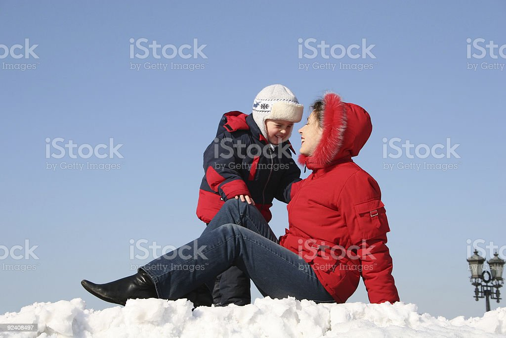 mother sit with son. winter royalty-free stock photo