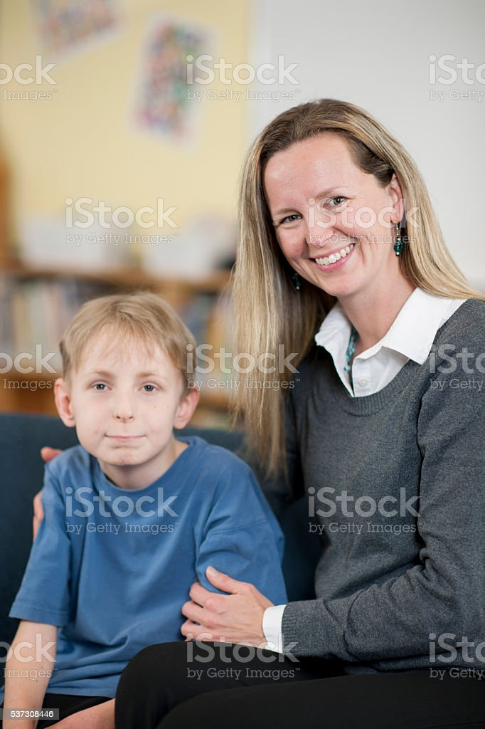 Mother Sitting with Her Son stock photo