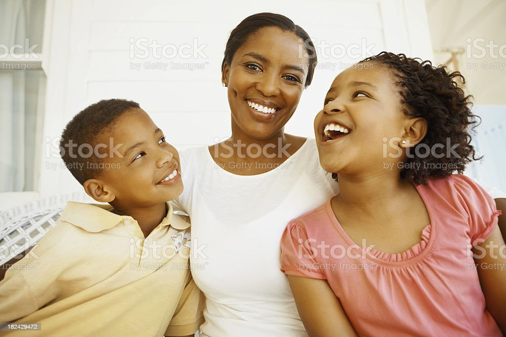 Mother smiling with son and daughter stock photo