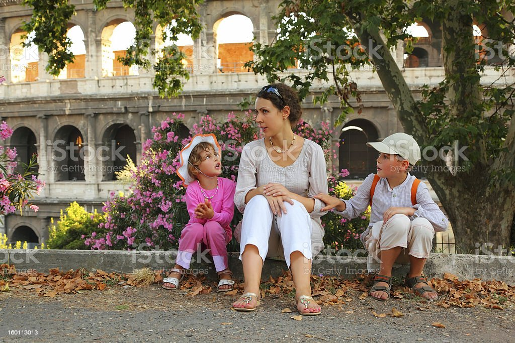 Mother, son and daughter sitting near Colosseum royalty-free stock photo