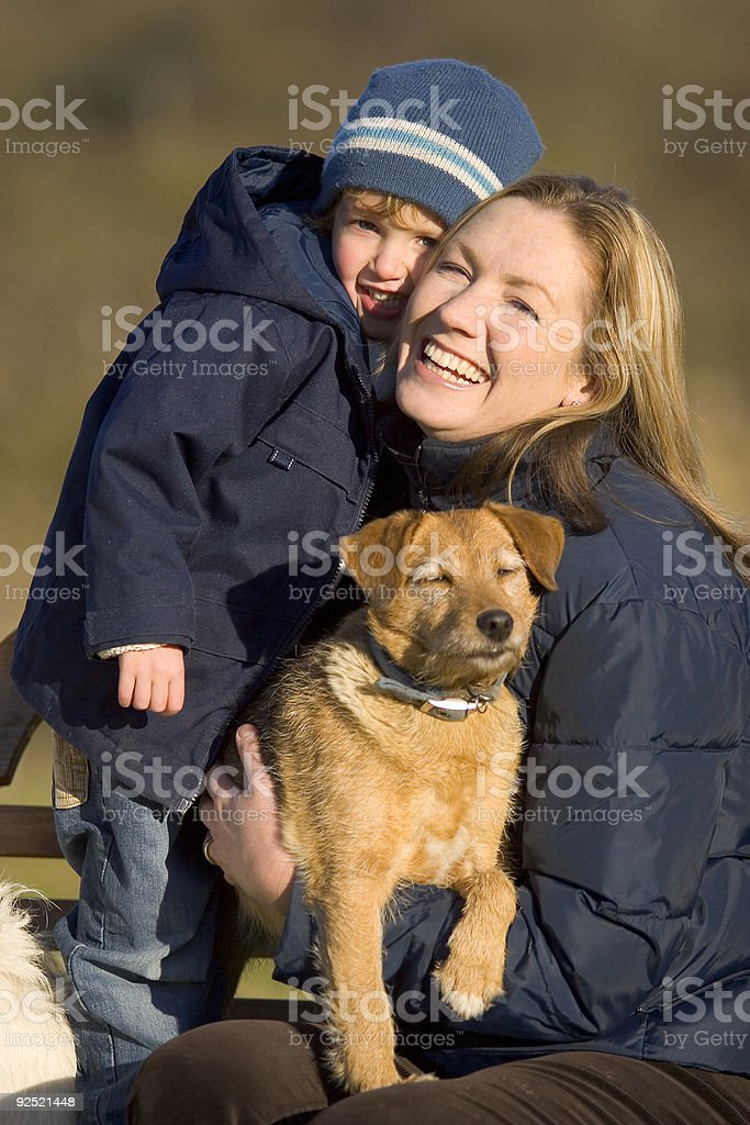 Mother Son and Family Dog Having Fun royalty-free stock photo