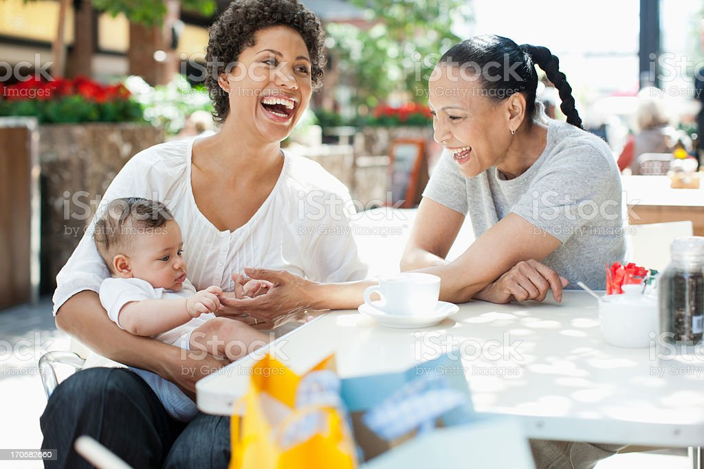 Mother, son and friend at outdoor cafe royalty-free stock photo