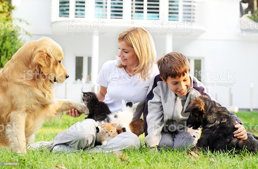 Mother, son and pets. royalty-free stock photo