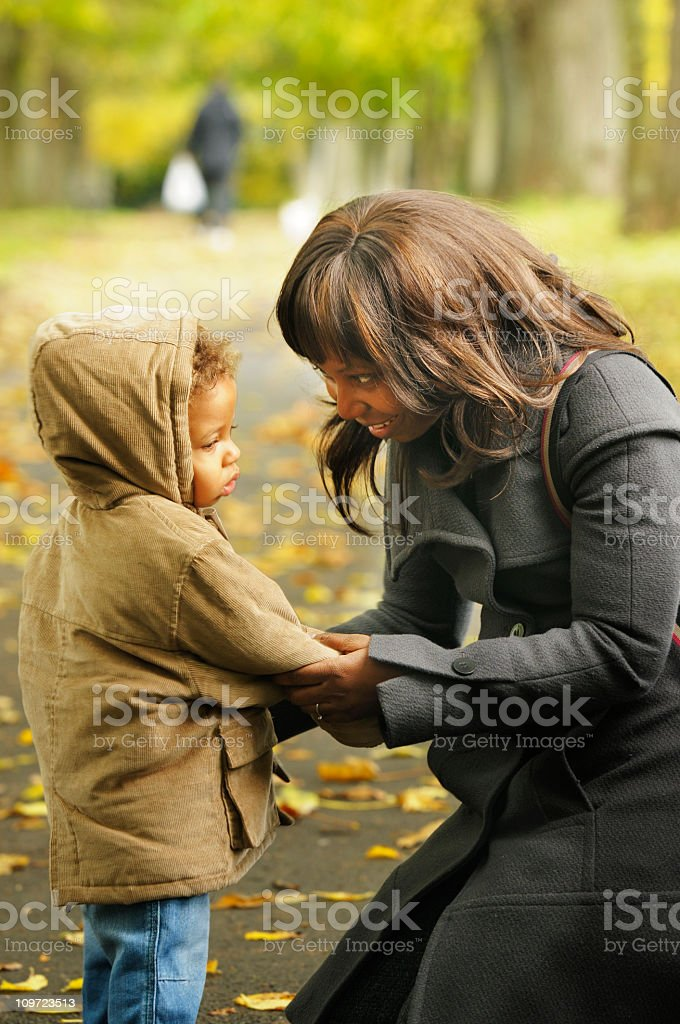 Mother Speaking To Her Son In The Park royalty-free stock photo