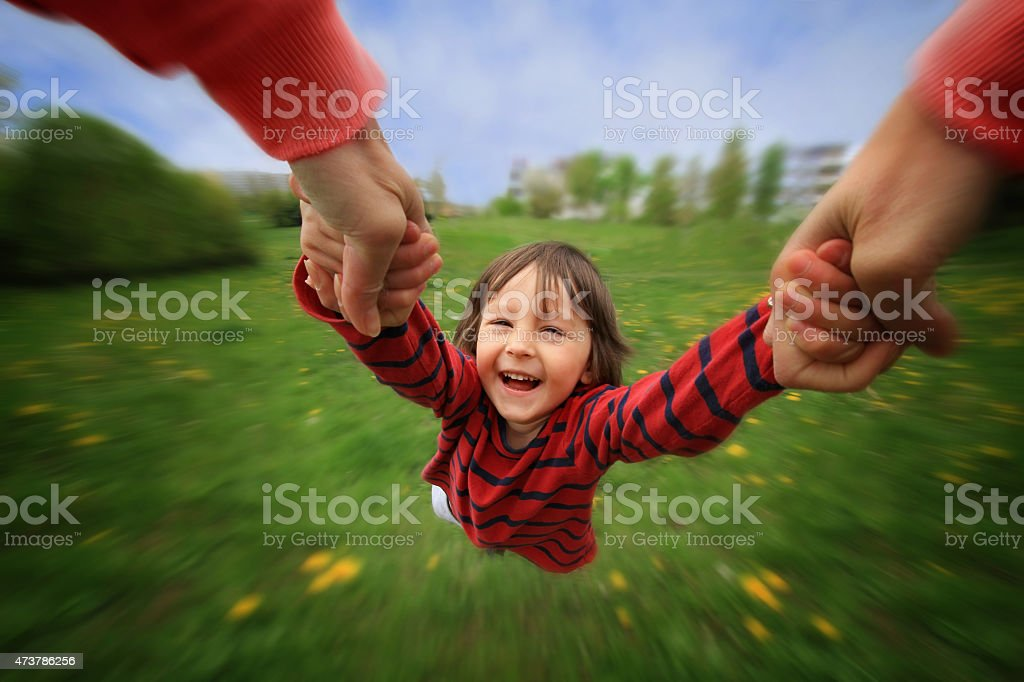 Mother, spinning in circle her little baby boy, pure joy stock photo