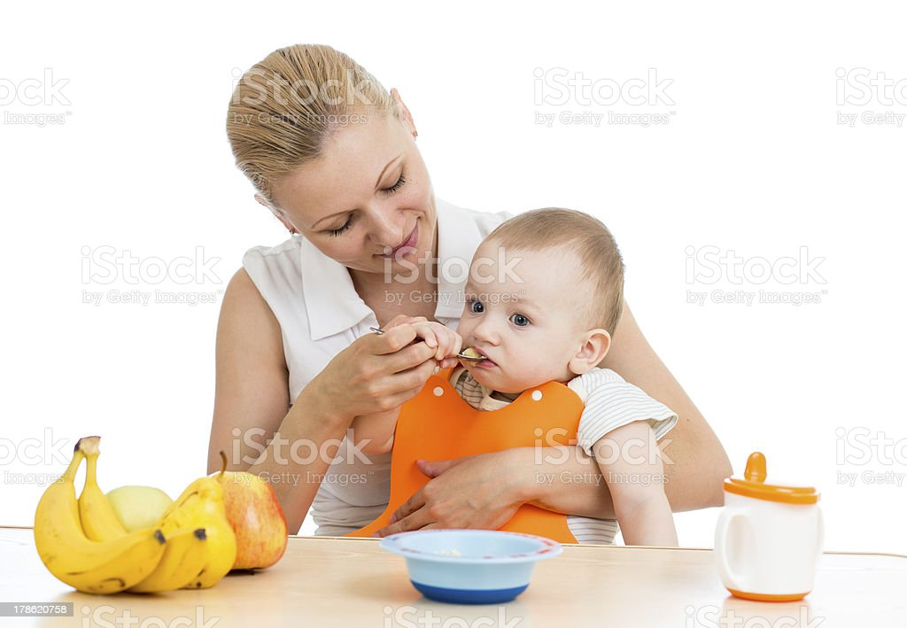 mother spoon feeding baby boy royalty-free stock photo