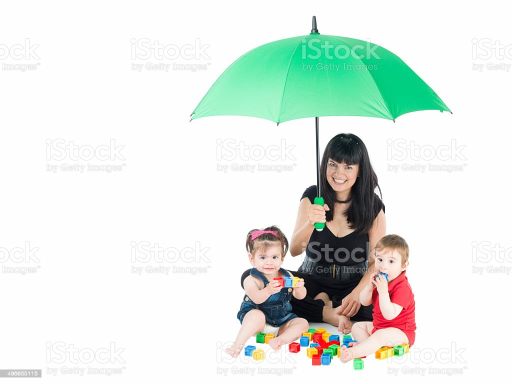 Mother taking care of babies,umbrella in hand stock photo