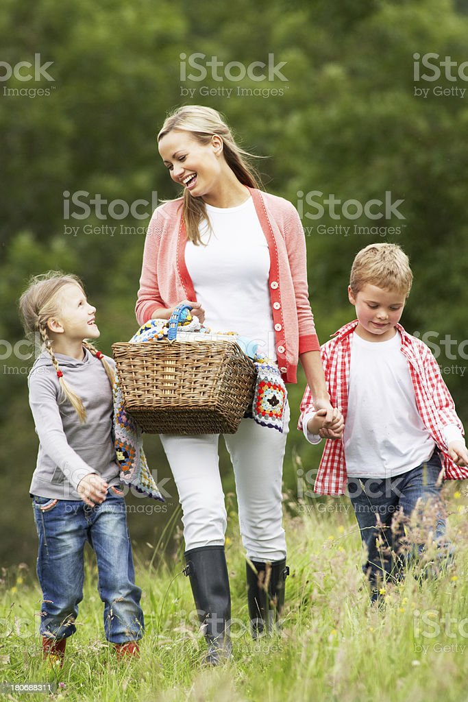 Mother Taking Children On Picnic In Countryside royalty-free stock photo