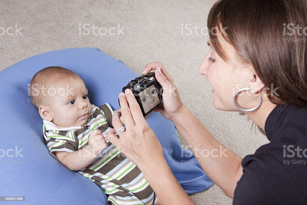 Mother Taking Photos of Baby royalty-free stock photo
