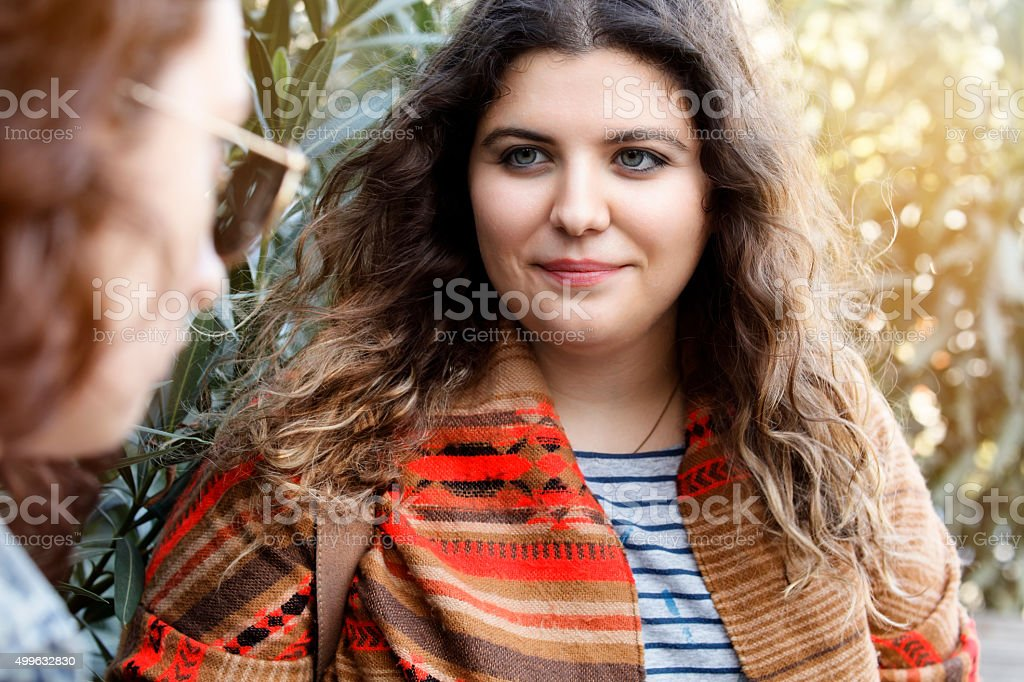 Mother talking to upset daughter stock photo