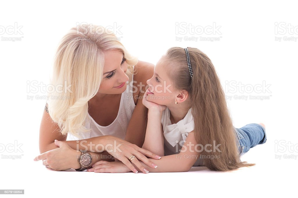 mother talking with her little daughter lying on the floor stock photo