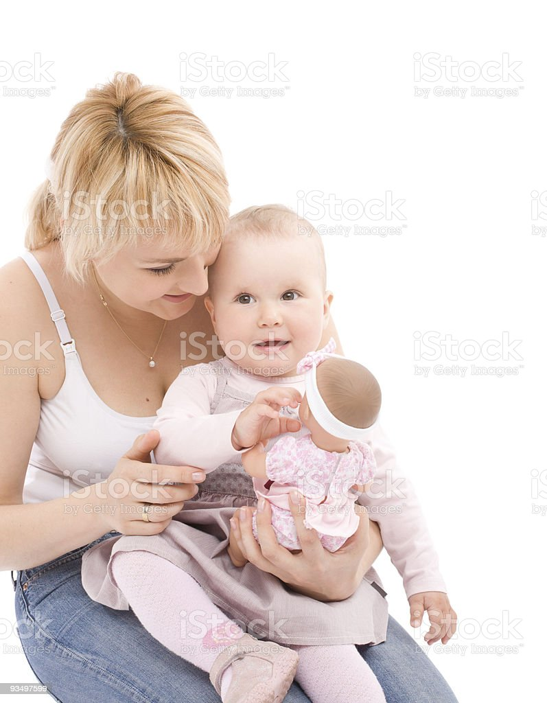 Mother teach her little baby girl play with doll stock photo