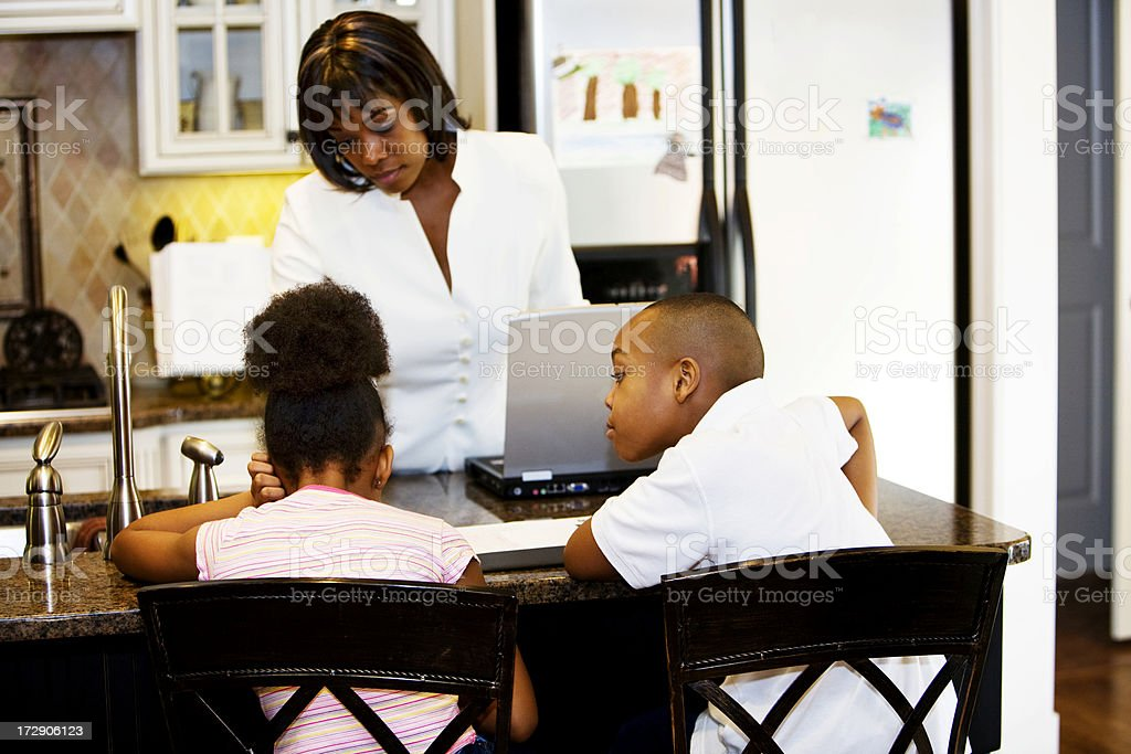 Mother Teaching Daughter and Son royalty-free stock photo