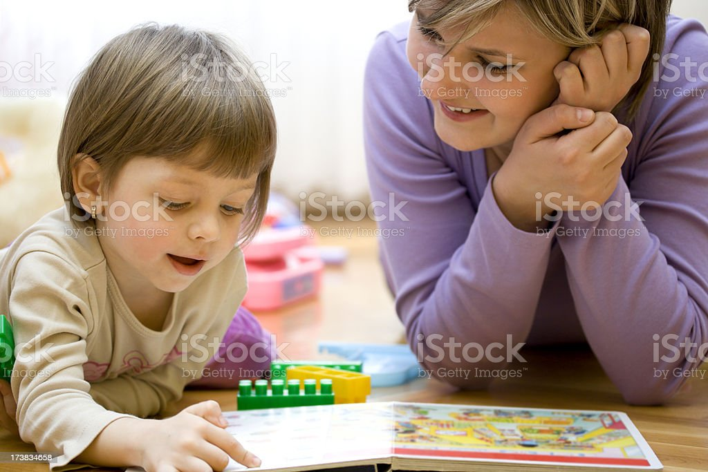 Mother teaching her little child royalty-free stock photo
