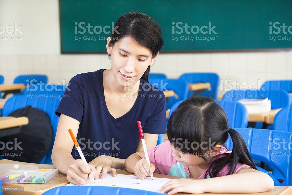mother teaching little girl drawing picture royalty-free stock photo