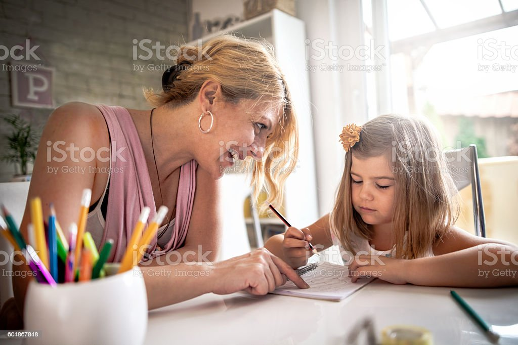 Mother Telling Off Daughter About Homework stock photo