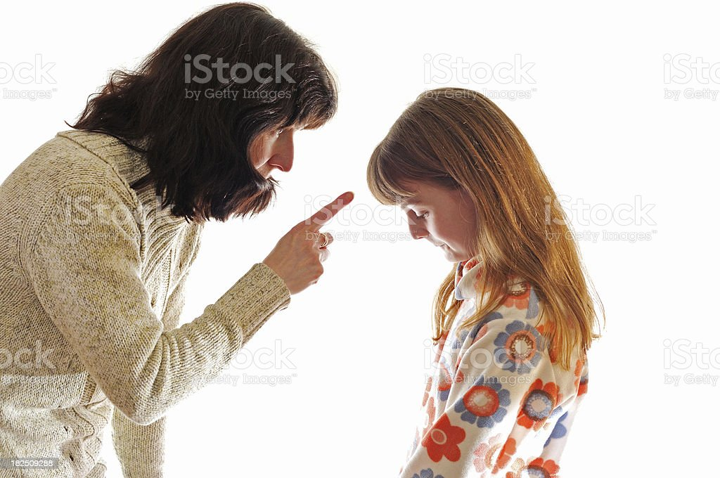 mother telling off daughter stock photo